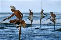 stilt fisherman, sri lanka by steve mccurry