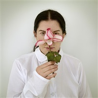 artist portrait with a rose by marina abramović
