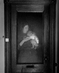 lisa and brady behind glass by abelardo morell
