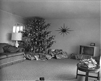 christmas tree in a living room in levittown, li by diane arbus