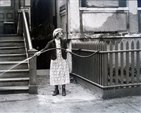 untitled (woman with hose) by helen levitt