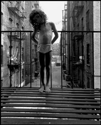child standing on fire escape (from east 100th street) by bruce davidson