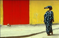 ivory coast. abidjan. a woman contributes to a colourful scene in the townships. 1976. by ian berry