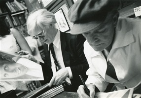 andy warhol signing copies of interview at fiorucci on east 59th street, with truman capote, whom he had idolized in his youth and became friends with in the 1970s by bob colacello