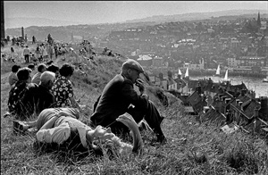 england. whitby. a sunny sunday afternoon brings tourists and residents on to the hill overlooking whitby harbour to relax and dream. 1974 by ian berry