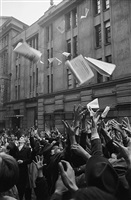 hungary. budapest. october-november 1956. insurrection. outside of the former central office of 'szabad nép', crowds try to catch the first edition of 'függetlenség' (independence). by erich lessing