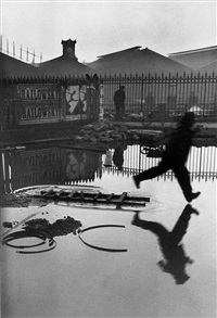 behind the gare saint-lazare by henri cartier-bresson
