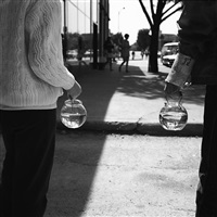 children holding fishbowls by vivian maier