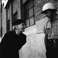 chicago (elderly woman and policeman) by vivian maier