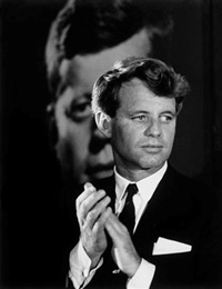 robert f. kennedy in front of a poster of his brother, columbus, ohio by bill eppridge