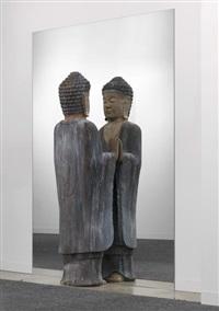 golden buddha and mirror by michelangelo pistoletto