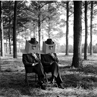 men with boxes on head, brunswick, ga by rodney smith