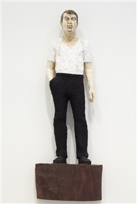 man with white t-shirt and black trousers by stephan balkenhol