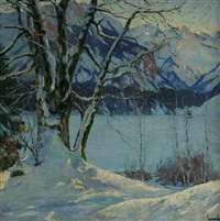 a frozen lake in a mountainous winter landscape by edward cucuel