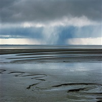 rain squall and mudflats, alaska by christopher burkett