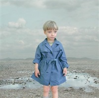 boy in a blue raincoat i by loretta lux
