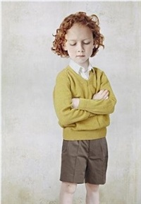 boy in a yellow pullover by loretta lux