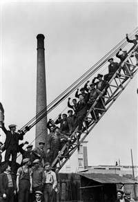 france. ile-de-france region. seine-saint-denis department. town of saint-ouen. national strike for the 40-hour week, paid holidays, and collective agreements. workers organise a sit-in at their steel factory. june 1936. by david 'chim' seymour