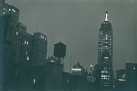 empire state building at night, new york by ilse bing