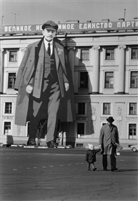 portrait of lenin on the facade of the winter palace for mayday celebrations by henri cartier-bresson