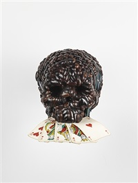 skull with poker hand by jan fabre