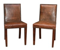 extremely rare pair of patinated oak chairs upholstered in brown tobacco leather and oxidized nails by jean-michel frank